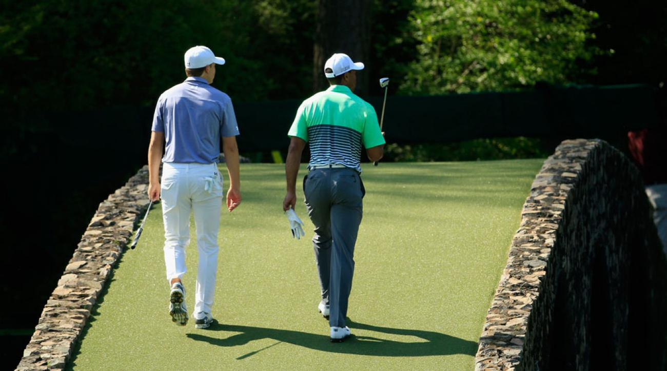 Jordan Spieth (left) and Tiger Woods (right) played together in a practice round alongside Ben Crenshaw at the 2015 Masters.