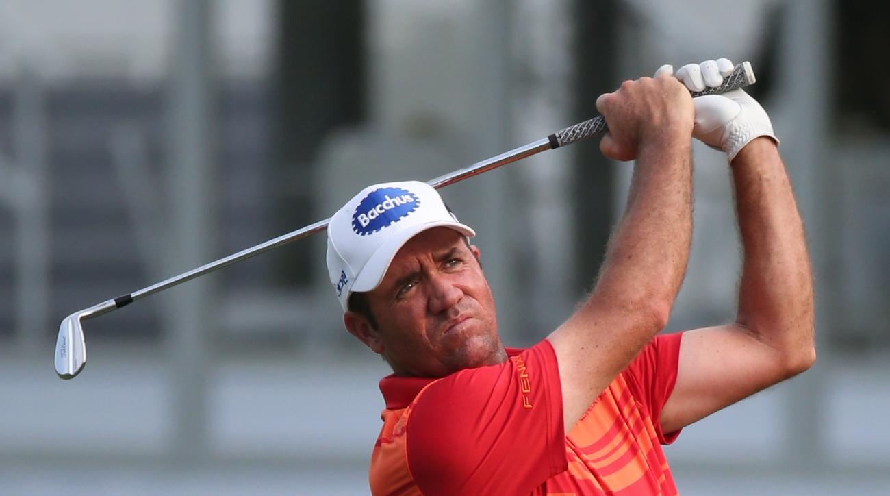 Scott Hend of Australia hits a shot from the fairway on the 17th hole during round 2 at the Hong Kong Open golf tournament in Hong Kong Friday, Oct. 23, 2015. (AP Photo/Kin