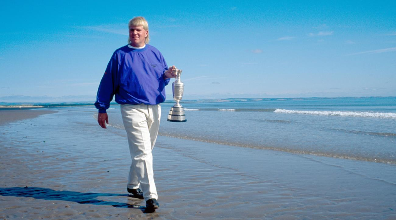 John Daly walks with the claret jug after winning the 1995 British Open.