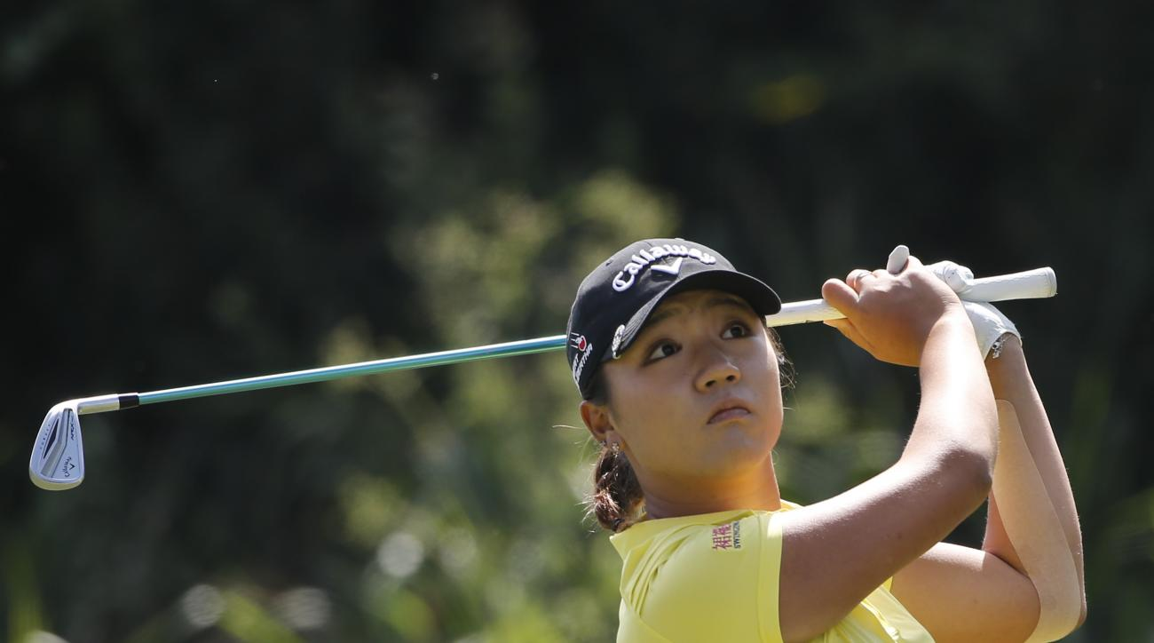 Lydia Ko, from New Zealand, watches her tee shot on the par three third hole during the final round of the Kia Classic women's golf tournament Sunday, March 27, 2016, in Carlsbad, Calif. (AP Photo/Lenny