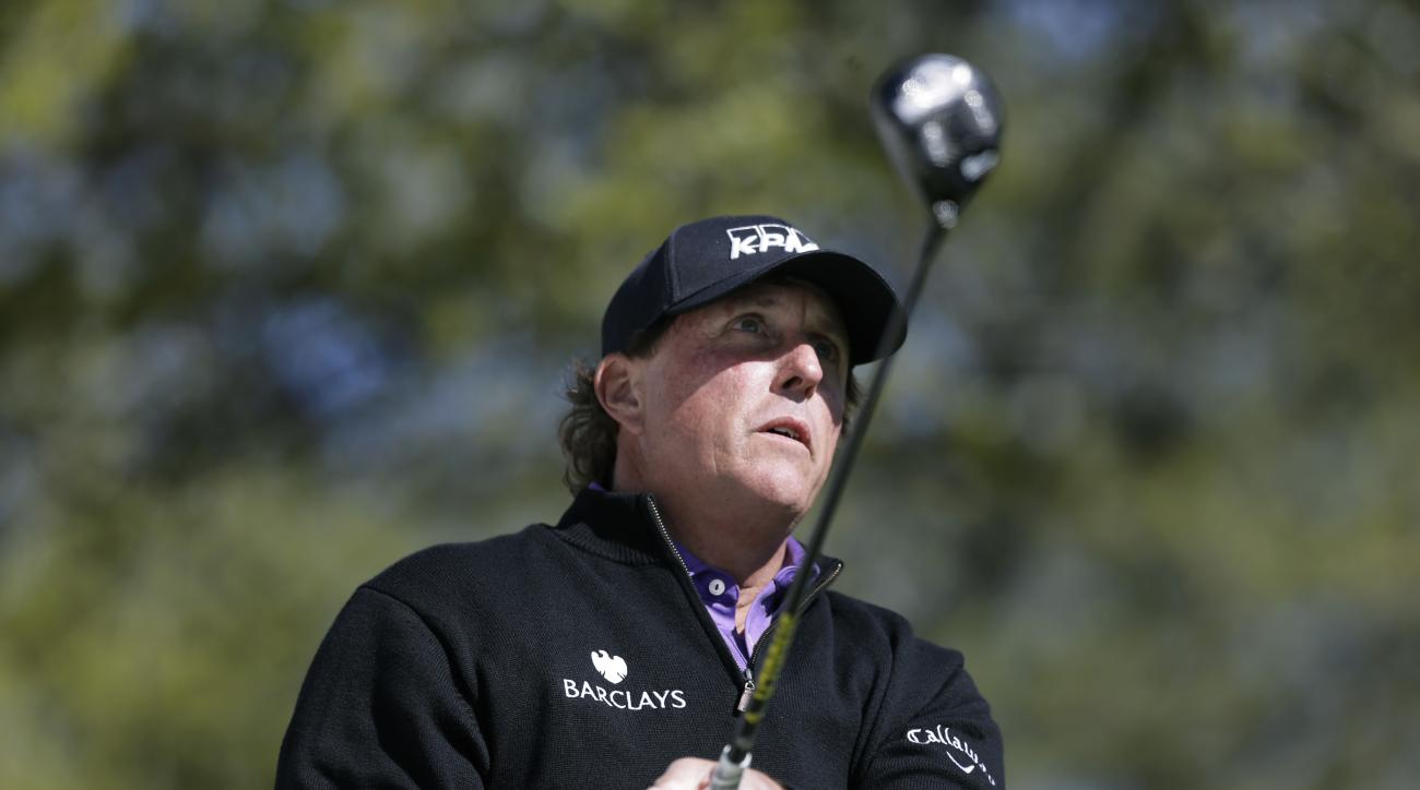 Phil Mickelson watches hit tee shot on the first hole during round-robin play at the Dell Match Play on March 24, 2016.