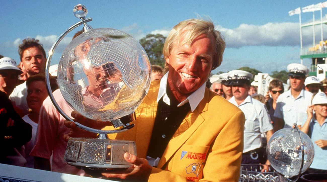 Greg Norman of Australia holds aloft the trophy after winning the Australian Masters. Norman won six total Australian Masters in his career.