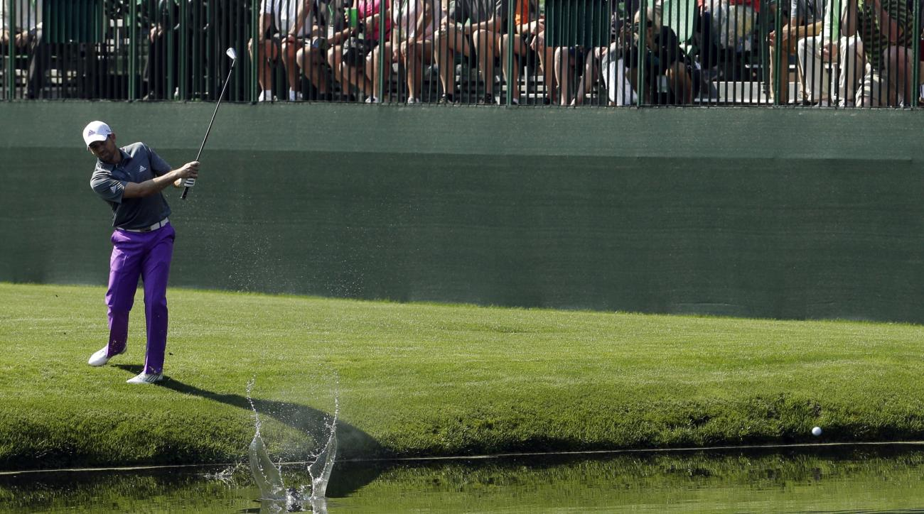 Sergio Garcia skips a ball across the water on the 16th hole during a practice round prior to the 2016 Masters.
