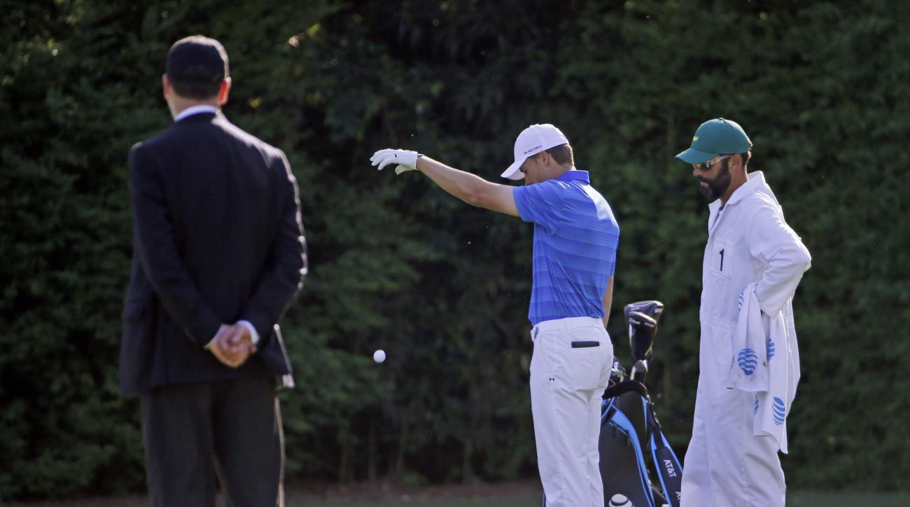 Jordan Spieth takes a second drop on the 12th hole after landing the water twice during the final round of the Masters golf tournament Sunday, April 10, 2016, in Augusta, Ga.