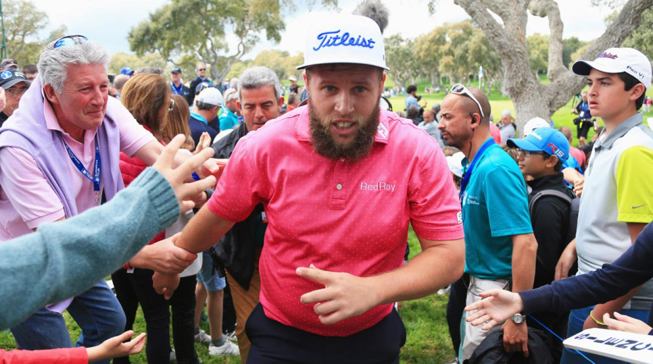 Andrew Johnston walks past spectators on the 18th green after his final round of the Spanish Open at Real Club Valderrama on April 17, 2016, in Sotogrande, Spain.