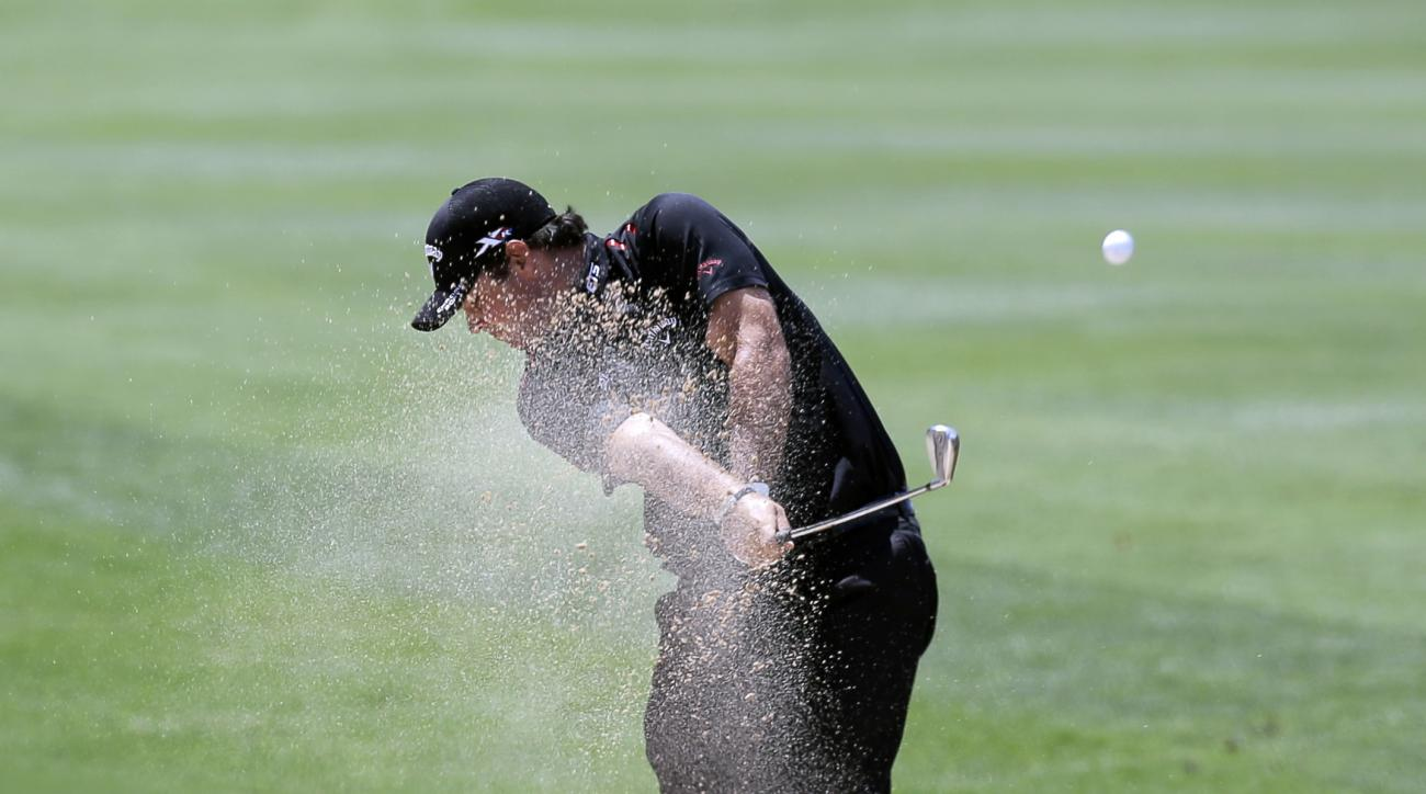 Patrick Reed plays a shot from a bunker on the sixth hole during the third round of the Texas Open golf tournament.