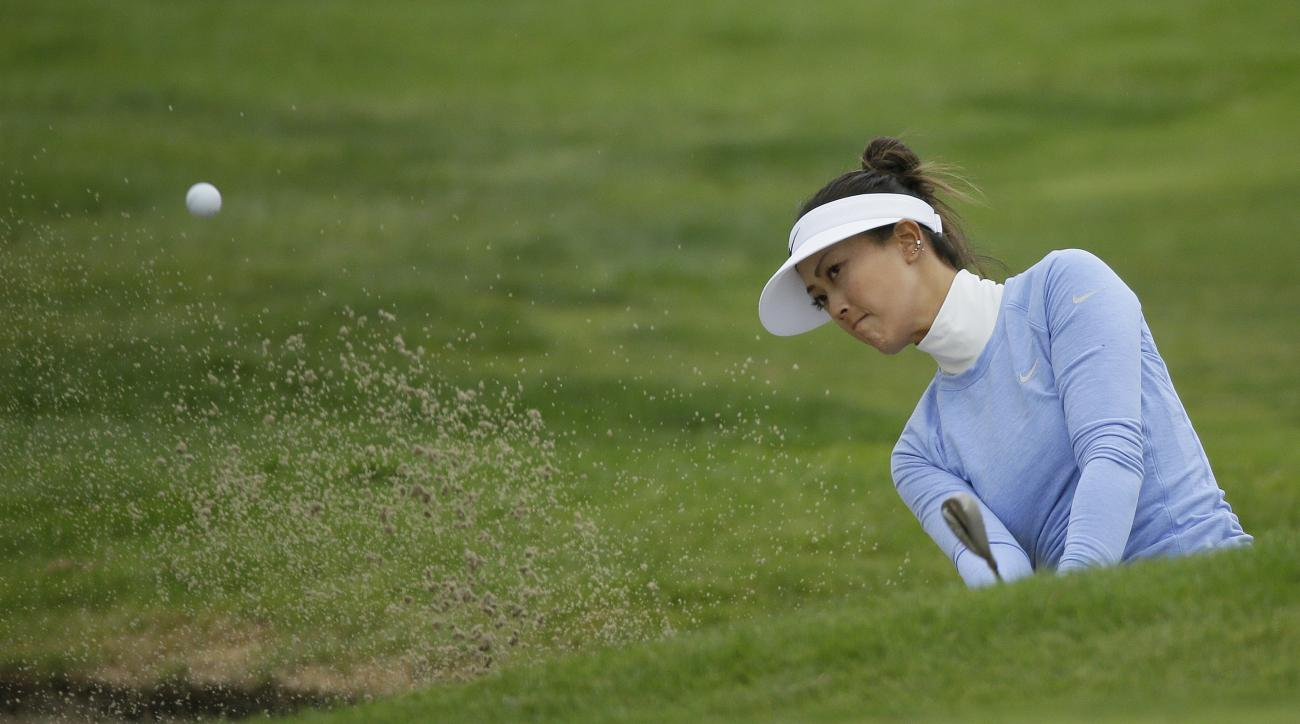 Michelle Wie hits out of a bunker up to the sixth green of the Lake Merced Golf Club during the second round of the Swinging Skirts LPGA Classic golf tournament Friday, April 22, 2016, in Daly City, Calif. (AP Photo/Eric