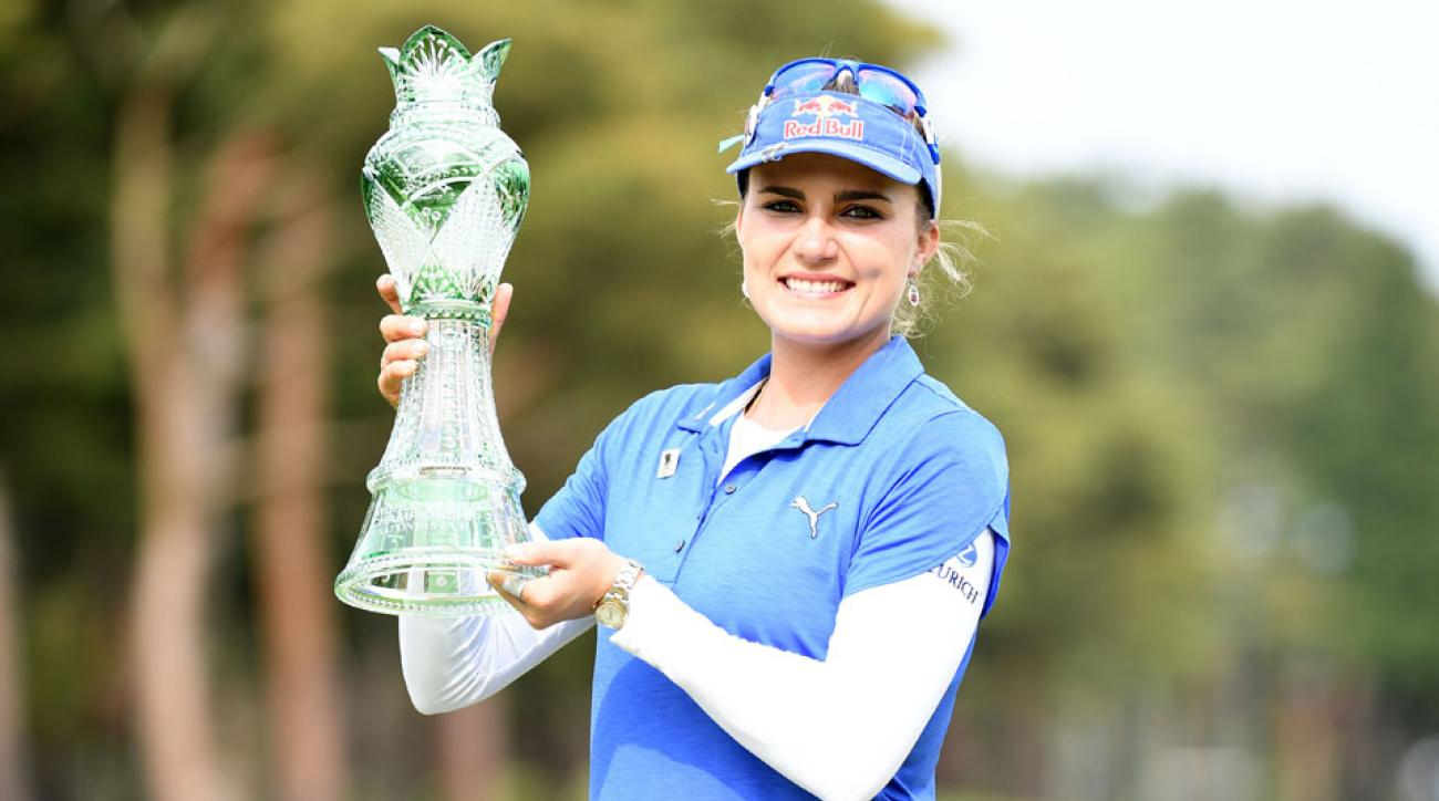 Lexi Thompson poses with the trophy after winning the World Ladies Championship Salonpas Cup at the Ibaraki Golf Club on May 8, 2016, in Tsukubamirai, Japan.