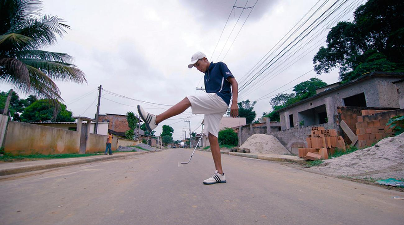 Breno Domingos shows off on the street where he grew up in Japeri, Brazil.