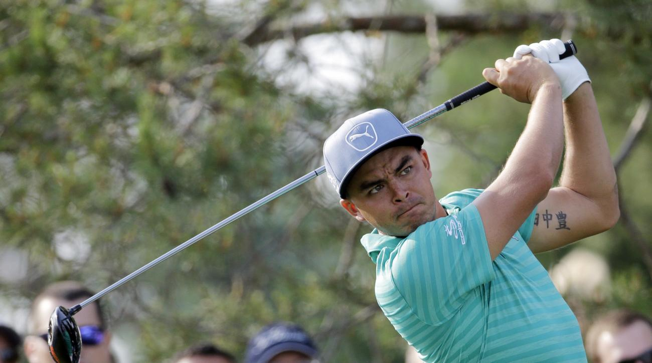 Rickie Fowler watches his tee shot on the 11th hole during the first round of the Memorial golf tournament, Thursday, June 2, 2016, in Dublin, Ohio. (AP Photo/Darron