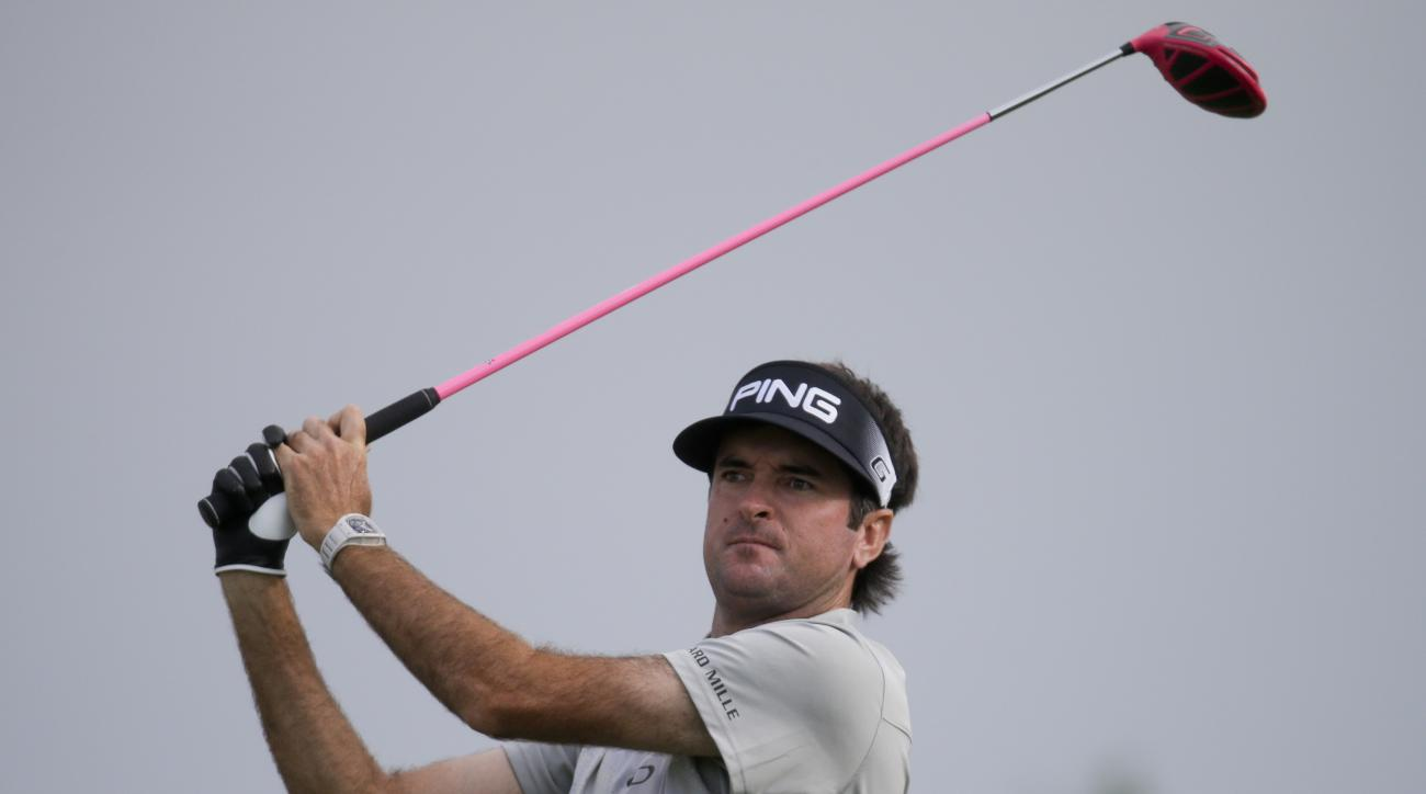 Bubba Watson watches his tee shot on the 18th hole during the rain delayed first round of the U.S. Open golf championship at Oakmont Country Club on Friday, June 17, 2016, in Oakmont, Pa. (AP Photo/John