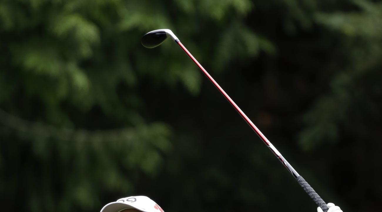Ayako Uehara, of Japan, smiles as she watches her tee shot in the first round at the Women's PGA Championship golf tournament at Sahalee Country Club Thursday, June 9, 2016, in Sammamish, Wash. (AP Photo/Elaine
