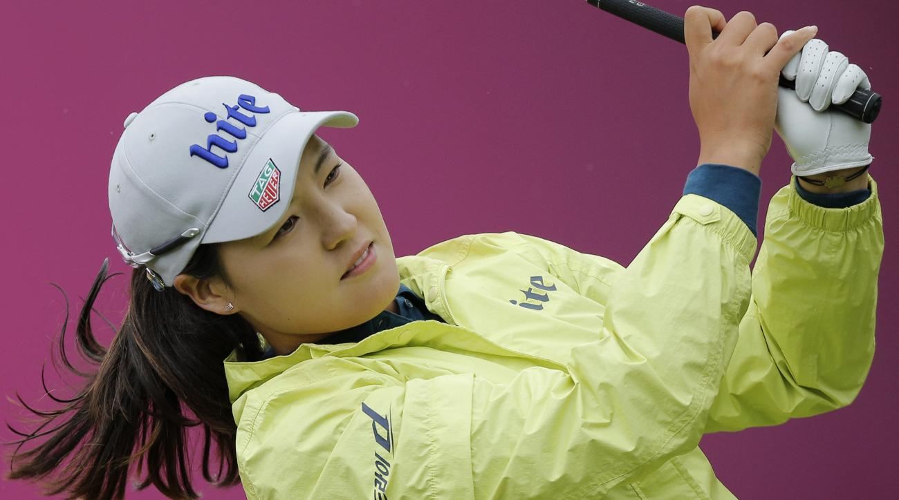 In Gee Chun of South Korea follows the flight of her ball after playing on the 2nd hole during the third round of the Evian Championship women's golf tournament in Evian, eastern France, Saturday, Sept. 17, 2016. (AP Photo/Laurent