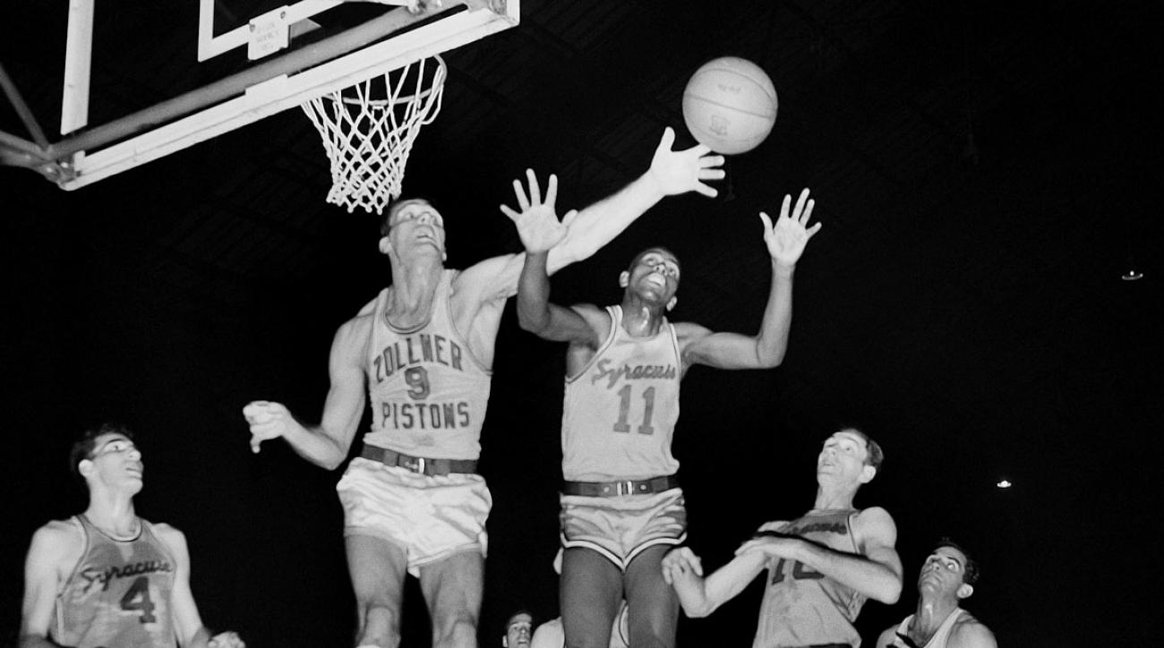 Fort Wayne's Mel Hutchins and Syracuse's Earl Lloyd reach for the ball during the 1955 NBA Finals. The Syracuse Nationals won the series 4-3 over the Fort Wayne Pistons.