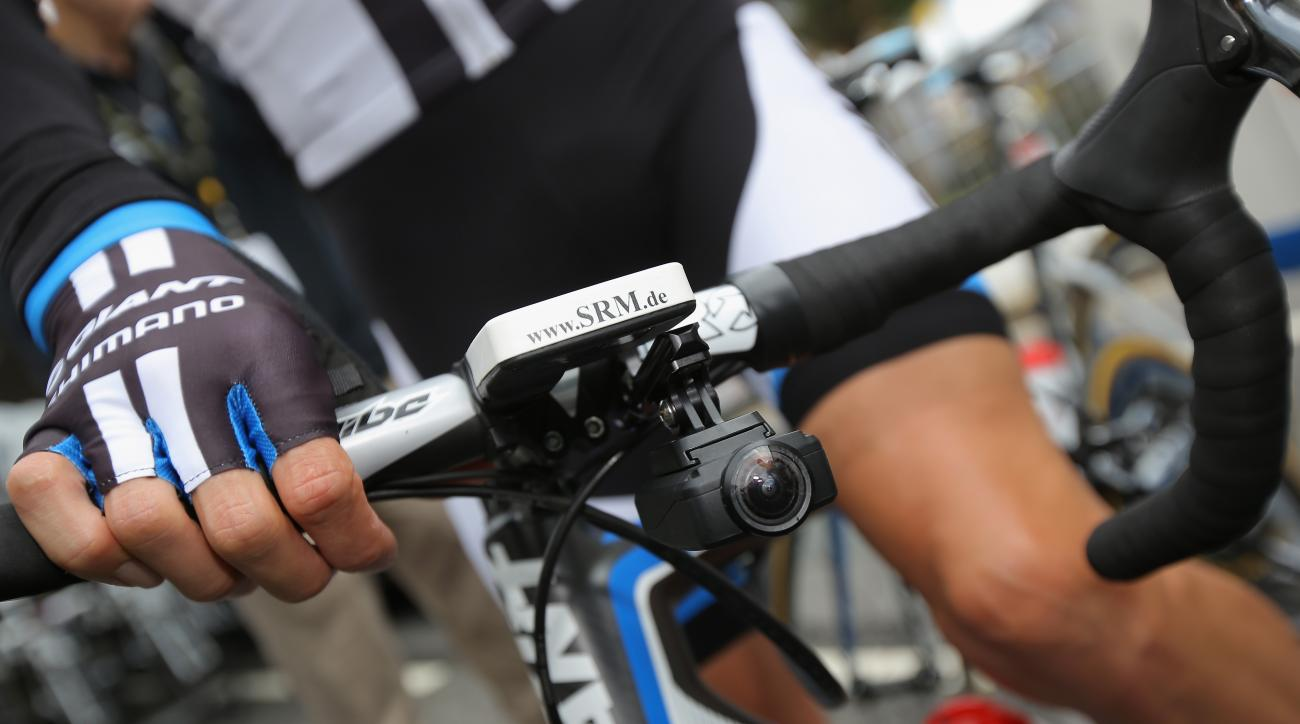 A small video camera is mounted under the handle bars of one of the riders during stage one of the 2014 Tour de France.