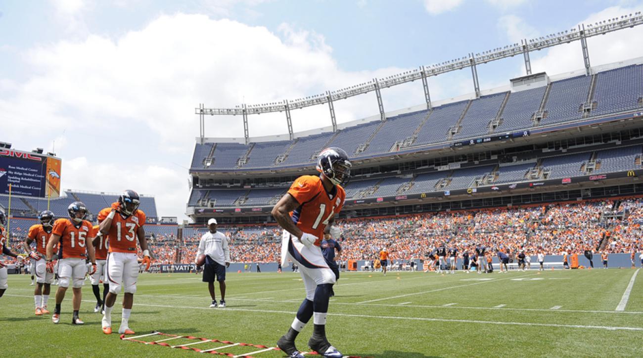 Denver Broncos wide receiver Cody Latimer (14) runs through drills on day four of the Denver Broncos 2014 training camp at Mile High.