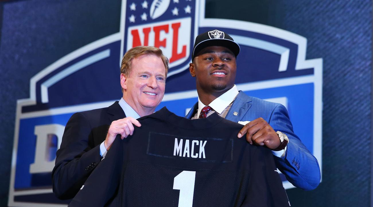 Mack poses with NFL Commissioner Roger Goodell after he was picked No. 5 overall by the Oakland Raiders during the first round of the 2014 NFL Draft.