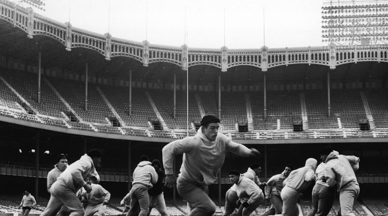 The New York Giants play in a practice game in a deserted and snowy Yankee Stadium in the late 1950s.