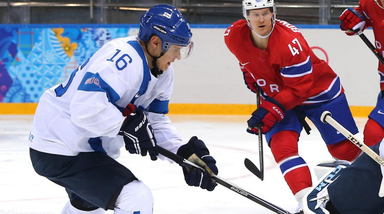 Aleksander Barkov defends Norway in the second period during the Men's Ice Hockey Preliminary Round Group B game on day seven of the Sochi 2014 Winter Olympics.
