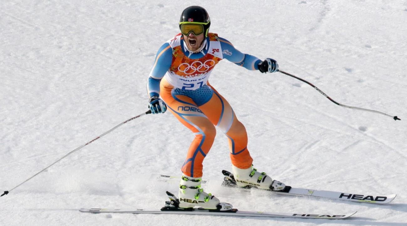 Norway's Kjetil Jansrud celebrates after his run in the men's super-G at the Sochi 2014 Winter Olympics.