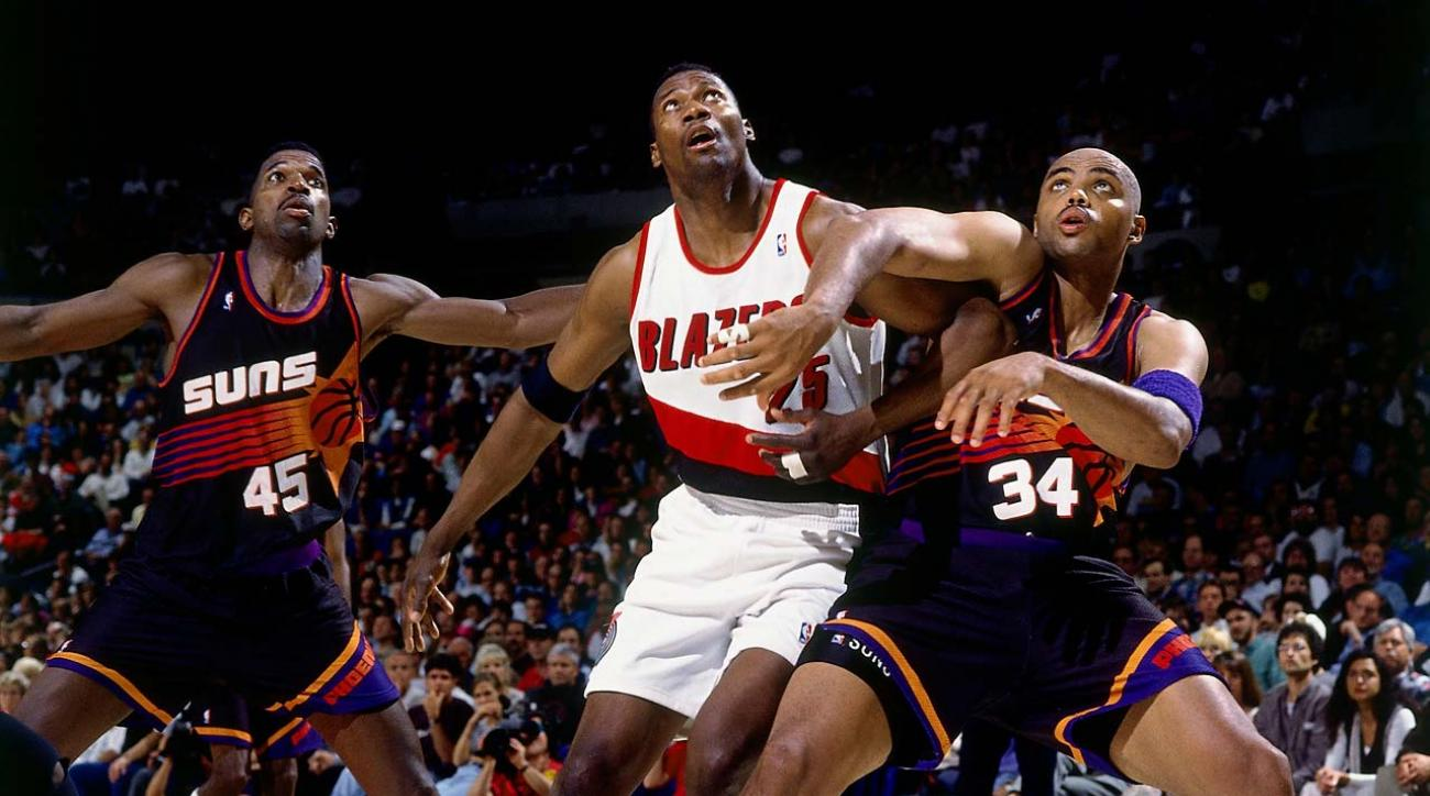 Charles Barkley and A.C. Green try to box out Jerome Kersey in Game 3 of the 1995 Western Conference quarterfinals.