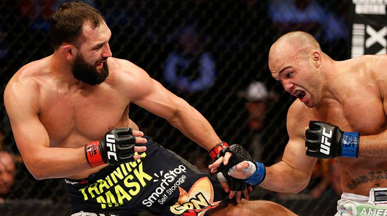 Johny Hendricks kicks Robbie Lawler in their UFC welterweight championship bout at UFC 171 inside American Airlines Center on March 15, 2014 in Dallas.