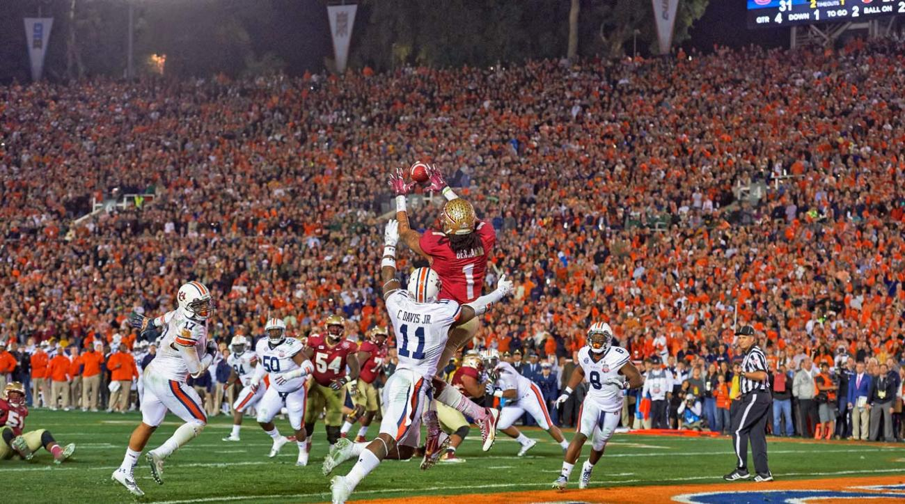 Florida State University's Kelvin Benjamin catches the game-winning touchdown from Jameis Winston with 13 seconds left in the BCS Championship Game, lifting them to a win over the Auburn Tigers.