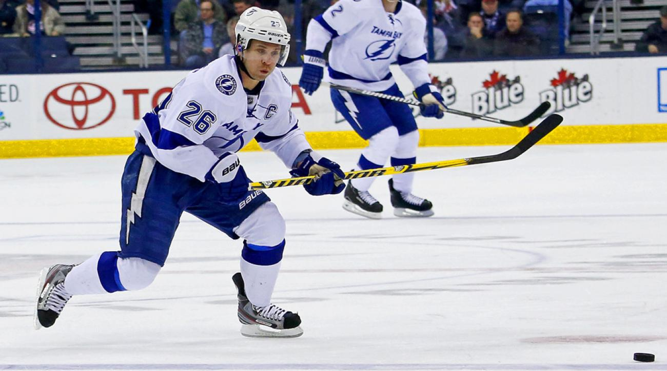 Martin St. Louis will replace Tampa Bay Lightning teammate Steven Stamkos on Canada's Olympic team.
