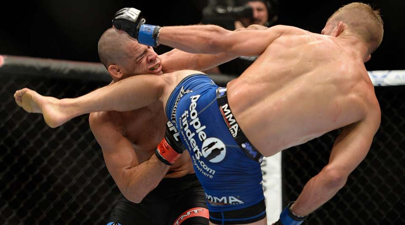 T.J. Dillashaw kicks Renan Barao in their bantamweight championship bout during the UFC 173 event at the MGM Grand Garden Arena on May 24, 2014 in Las Vegas.