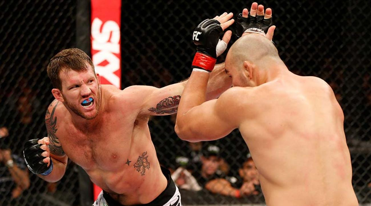 Ryan Bader punches Glover Teixeira in their light heavyweight fight during the UFC on FOX Sports 1 event on Sept. 4, 2013 in Belo Horizonte, Brazil.