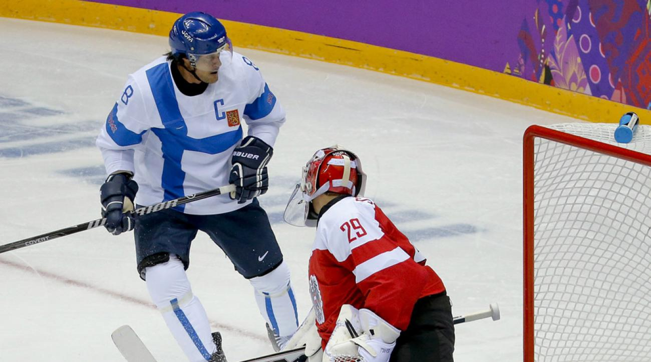 Teemu Selanne was seen getting his neck checked out by trainers after the first period of Finland's game against Austria.