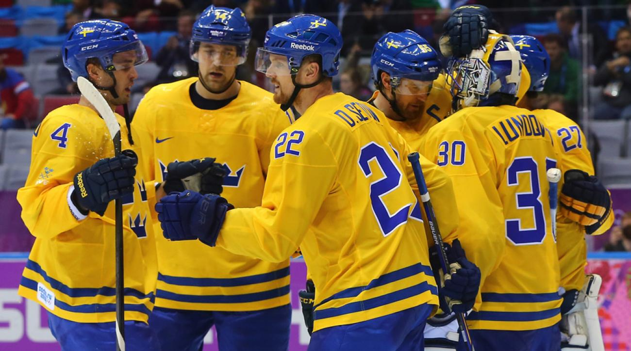 Members of Sweden's hockey team congratulated goaltender Henrik Ludqvist after the squad's 1-0 victory over Switzerland.