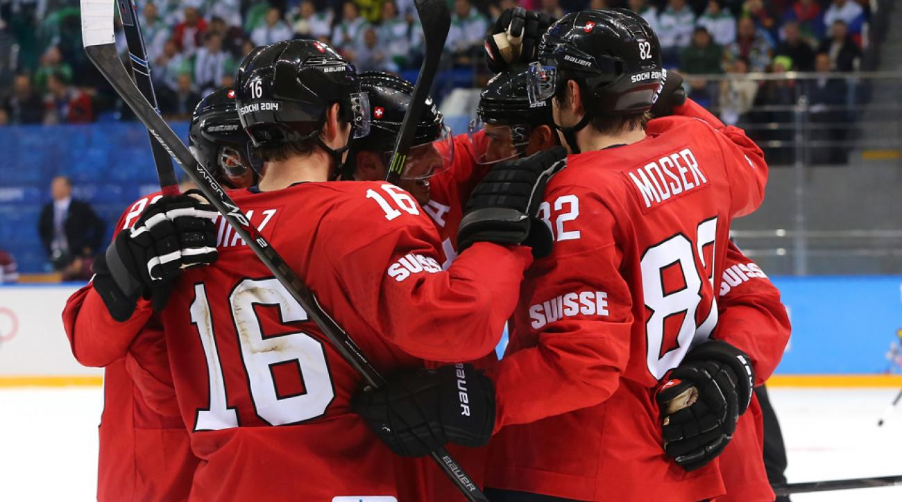 Switzerland celebrates its game-winning goal late in the third period against Latvia.