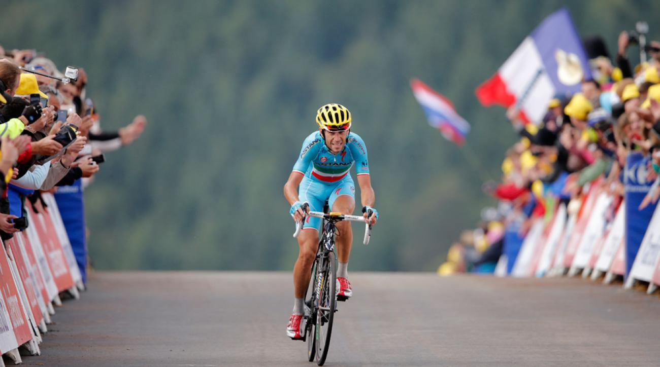 Italy's Vincenzo Nibali crosses the finish line to win the tenth stage of the Tour de France cycling race over 161.5 kilometers (100.4 miles) with start in Mulhouse and finish in La Planche des Belles Filles, France, Monday, July 14, 2014.