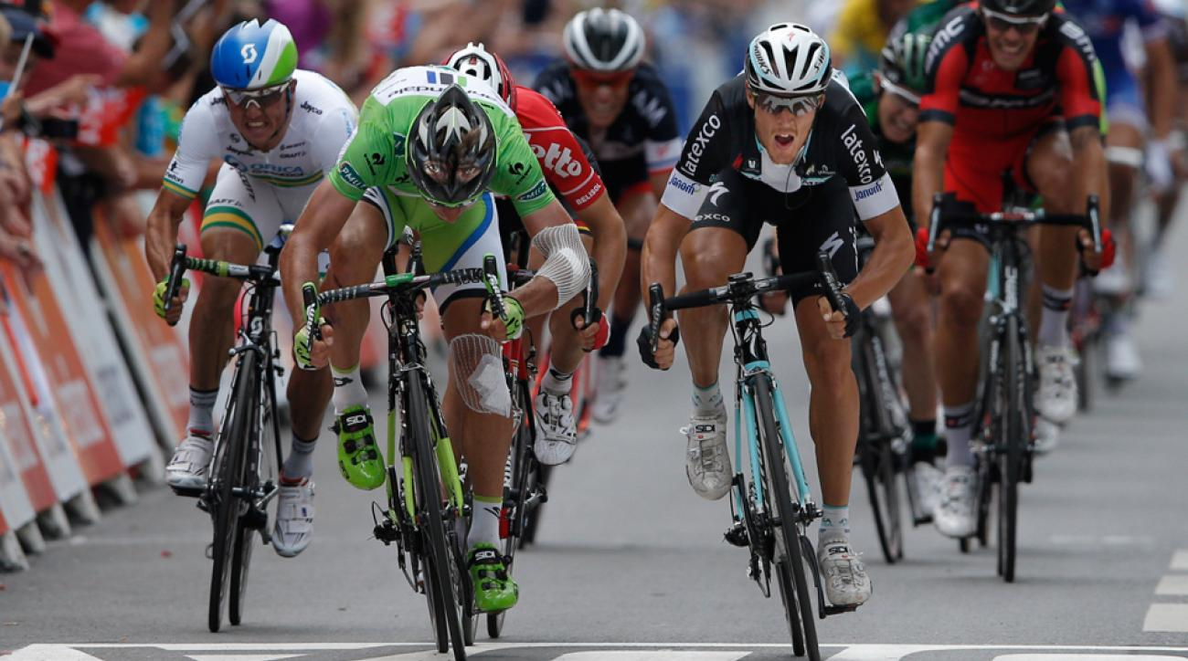 Italy's Matteo Trentin, right, crosses the finish line ahead of second place Peter Sagan of Slovakia, second left, and fifth place Australia's Simon Gerrans, left, to win the seventh stage of the Tour de France cycling race over 234.5 kilometers (145.7 miles) with start in Epernay and finish in Nancy, France, Friday, July 11, 2014.