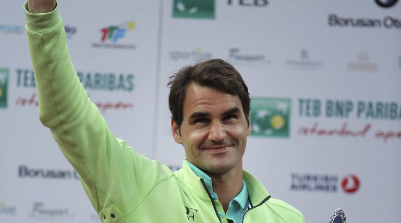 Roger Federer of Switzerland celebrates with his trophy after beating Pablo Cuevas of Uruguay following the final match of the Istanbul Open tennis tournament at Garanti Koza Arena in Istanbul, Turkey, Sunday, May 3, 2015. The Istanbul Open was the first