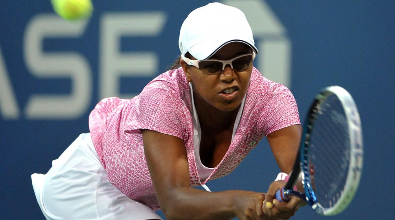 In this Aug. 29, 2013, file photo, Victoria Duval of the United States, stretches for a backhand return against Daniela Hantuchova of Slovakia at the U.S. Open Tennis tournament in New York. Duval has received a wild-card entry for U.S. Open qualies.