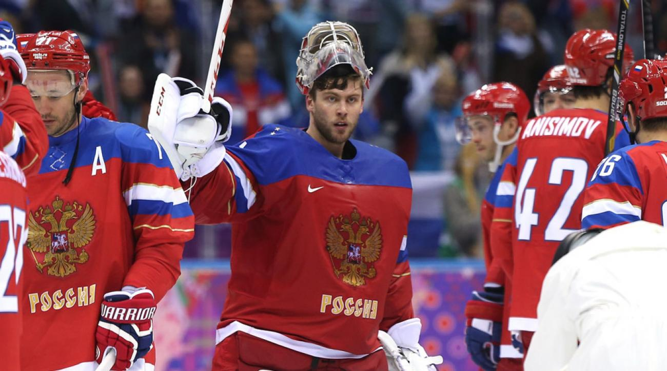 Semyon Varlamov of Russia celebrates with teammates after defeating Slovenia 5-2 during the Men's Ice Hockey Preliminary Round Group A game on day six of the Sochi 2014 Winter Olympics.