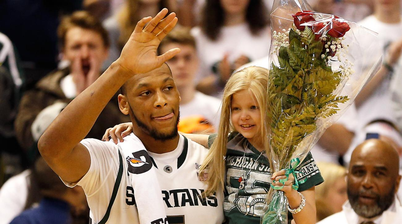 Adreian Payne celebrated the Spartans' Big Ten title with fan Lacey Holsowrth, who died of cancer a few weeks later.