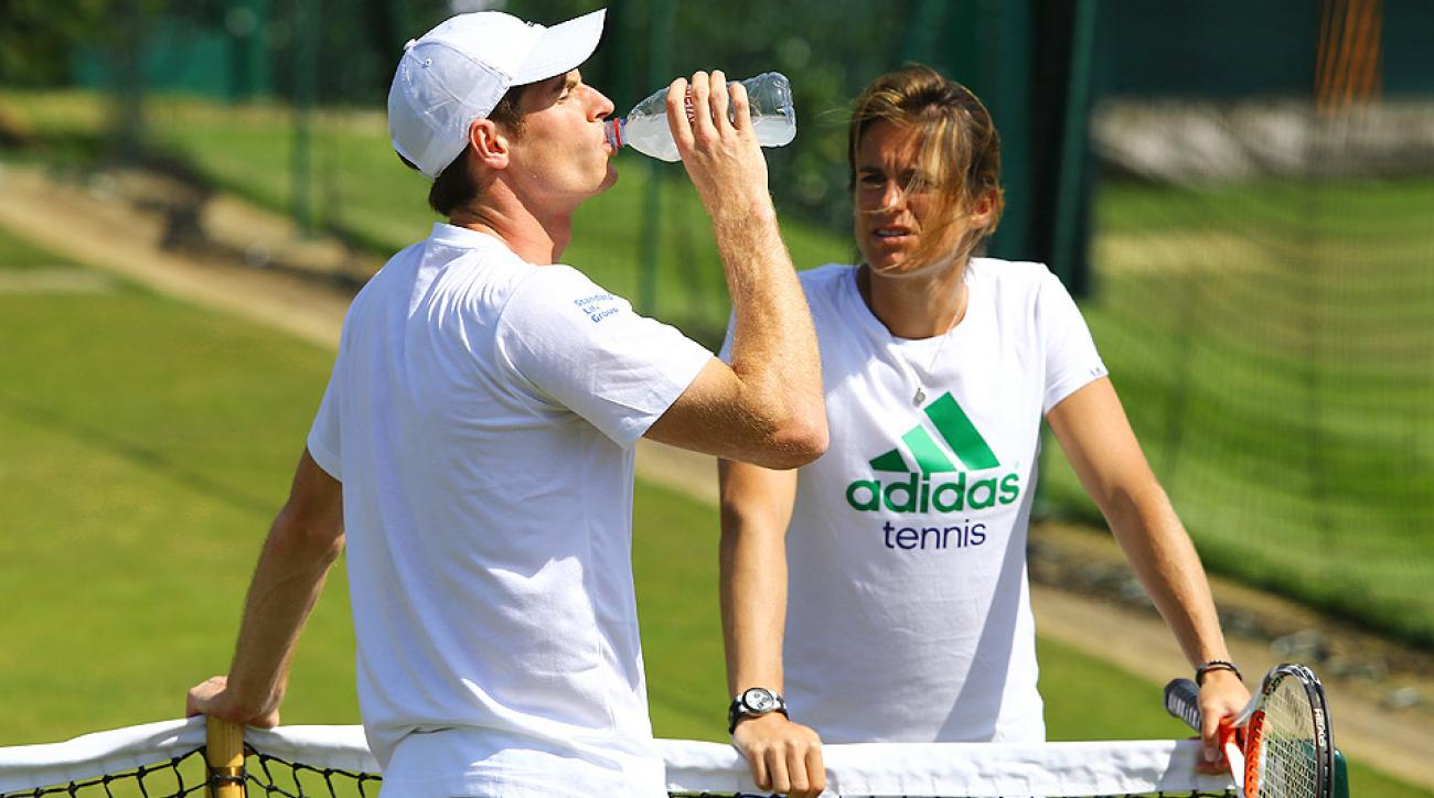 Andy Murray warms up with coach Amelie Mauresmo on the Wimbledon practice courts.