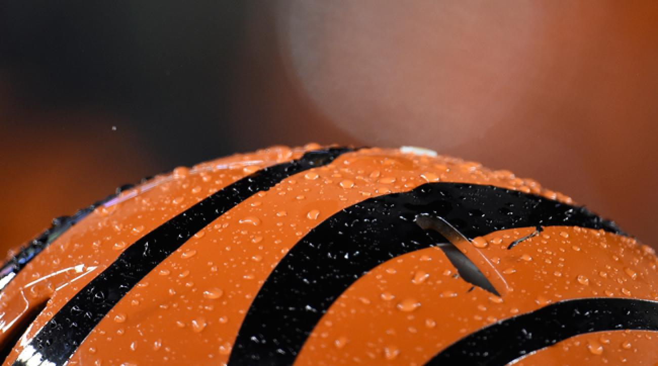 A Cincinnati Bengals helmet stands in the rain during the January 2015 Steelers-Bengals wild-card game.