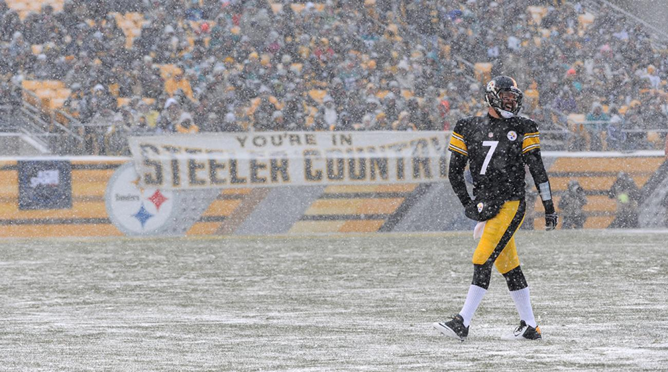Pittsburgh Steelers quarterback Ben Roethlisberger warms his hands as snow falls during a game in December 2013.