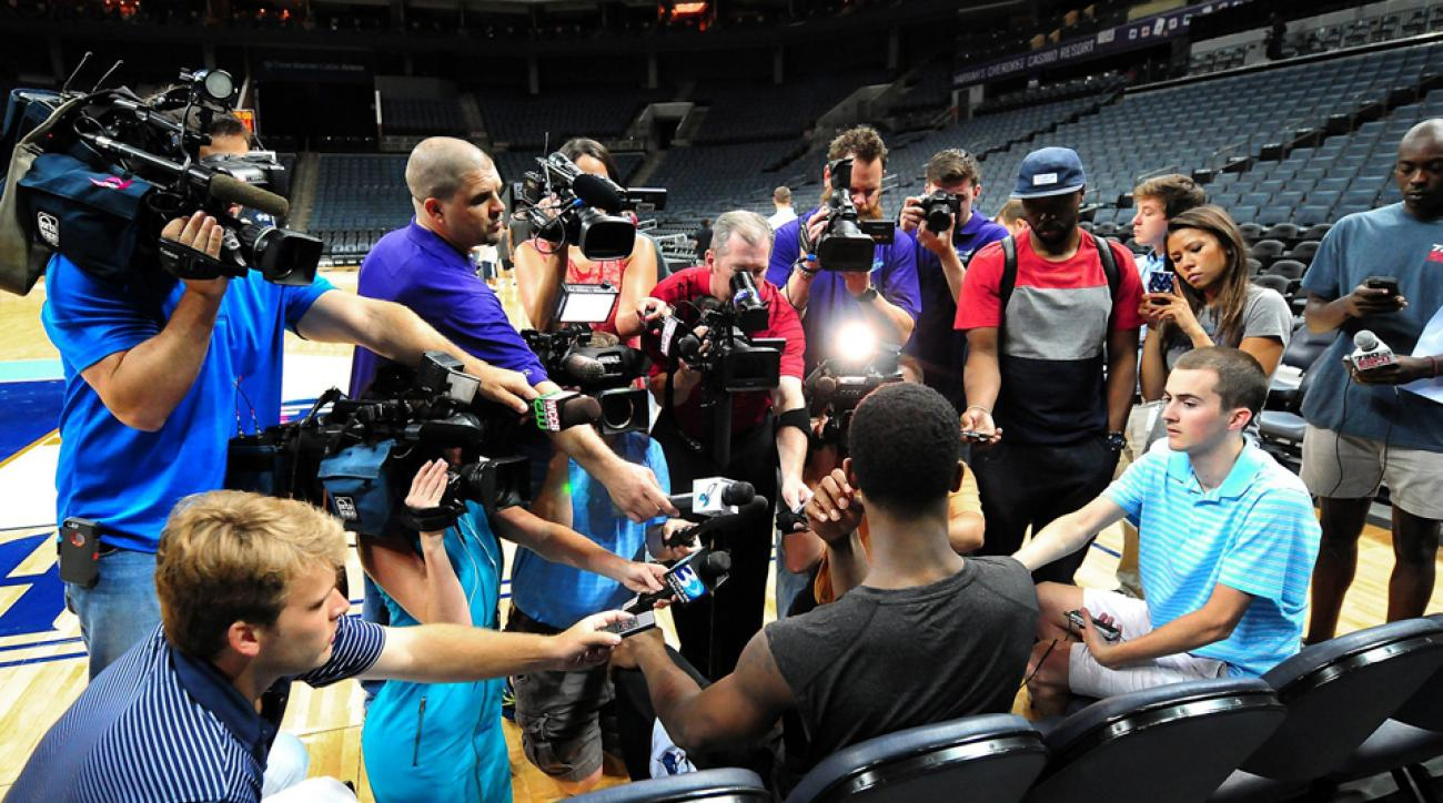 Local media surround C.J. Fair for an interview following the Charlotte Hornets' 2014 NBA Draft Workout at Time Warner Cable Arena in Charlotte, N.C.