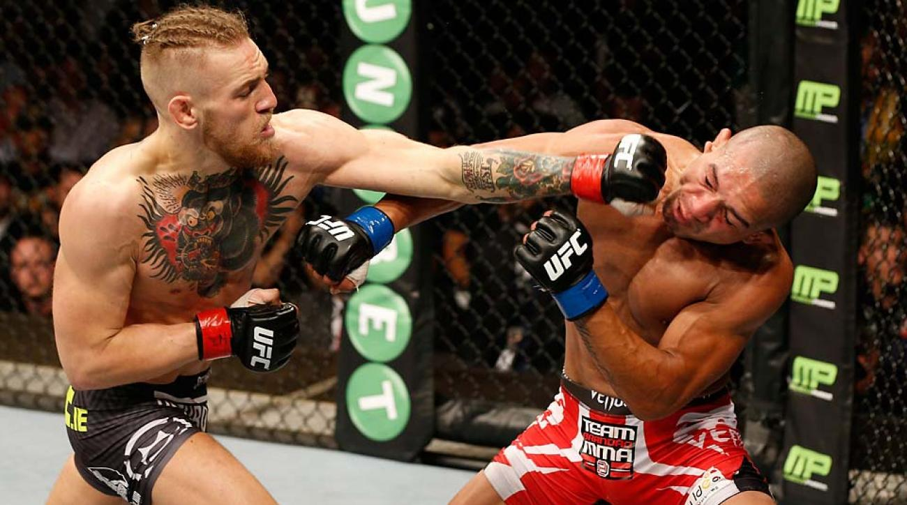 Conor McGregor lands a left to the head of Diego Brandao in their featherweight bout on July 19, 2014, in Dublin, Ireland.