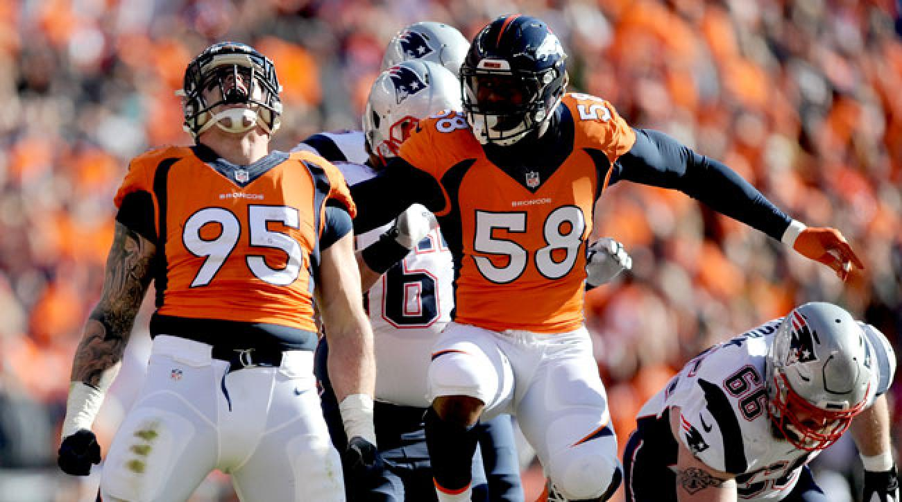 Derek Wolfe and Von Miller celebrate during their AFC Championship win against the Patriots.