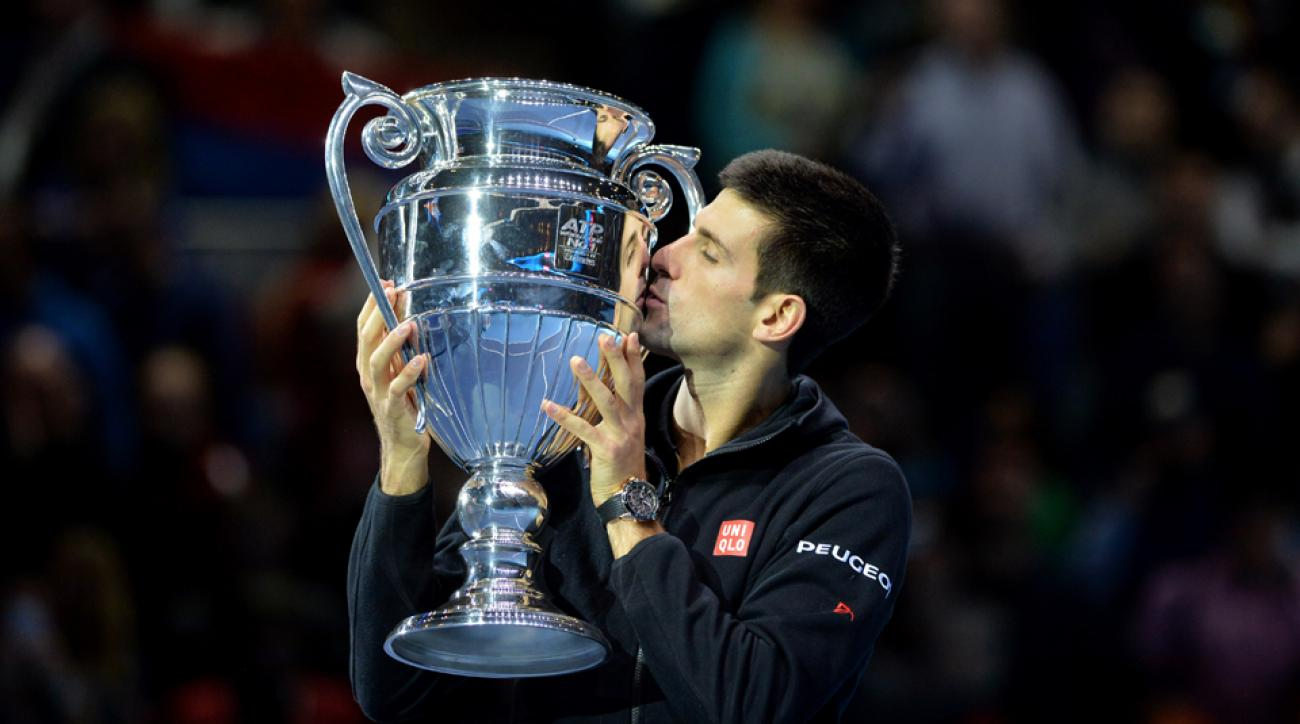 Djokovic kisses the ATP World No. 1 Award trophy after his win over Berdych in round robin play in London.