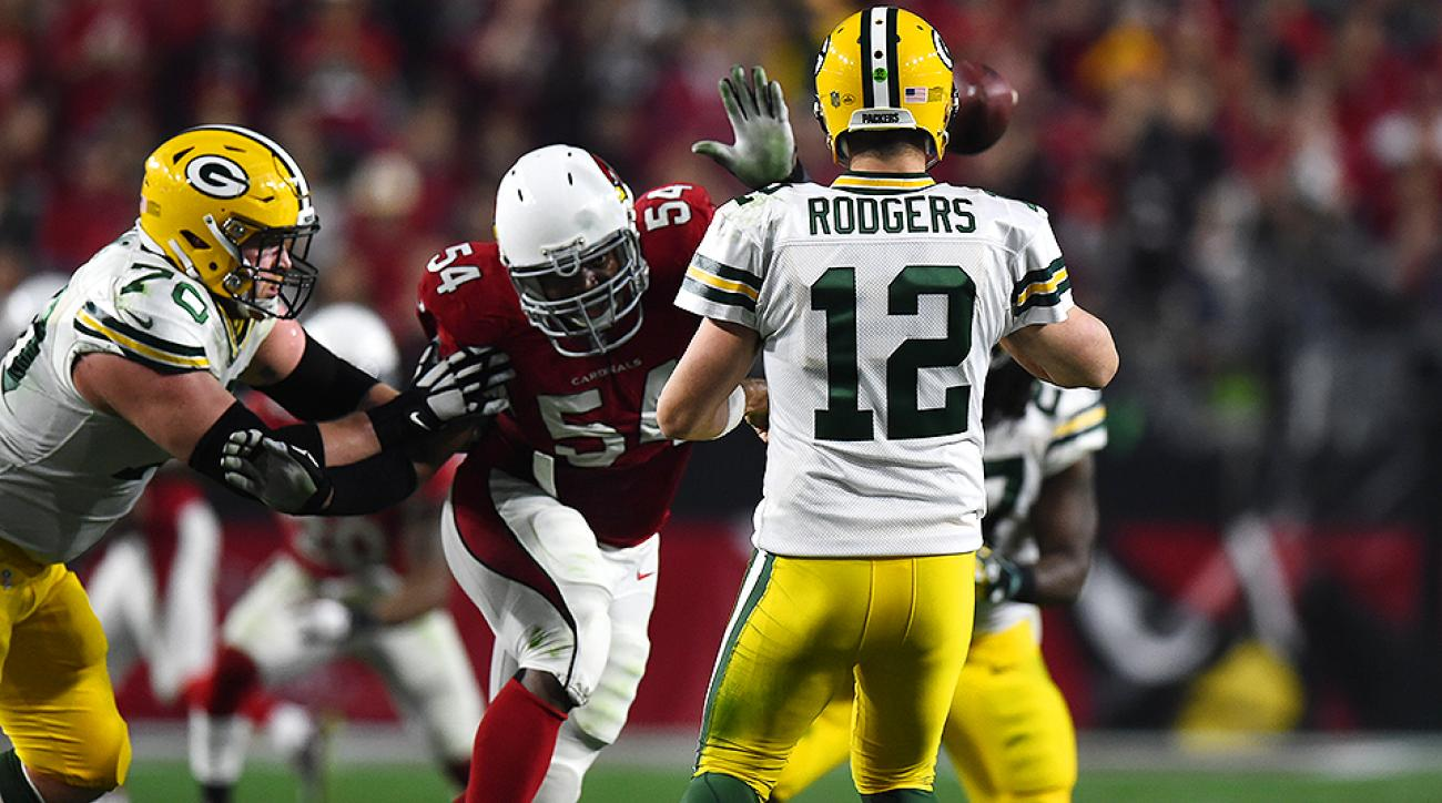 Dwight Freeney (54) chases down Aaron Rodgers.