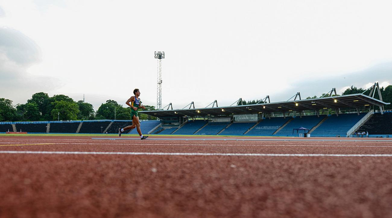 A runner training at the track in London.