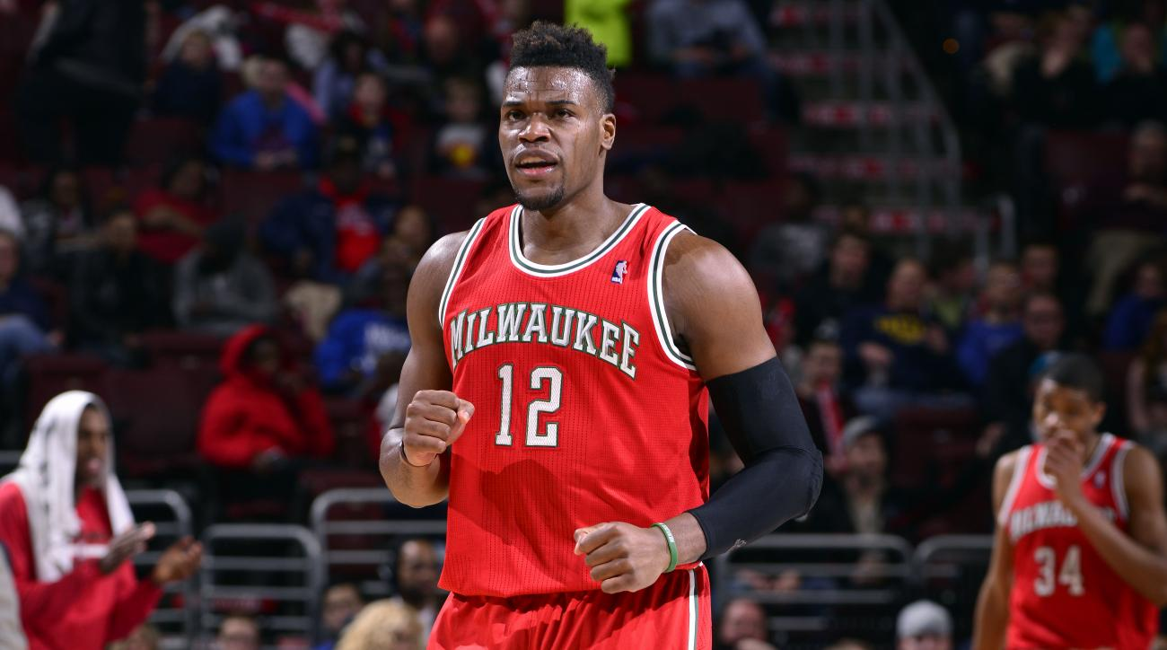 Jeff Adrien signs with Houston Rockets