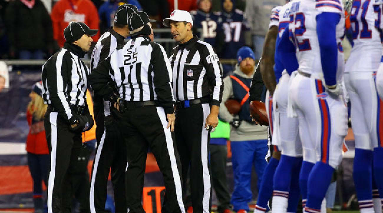 Gene Steratore's officiating crew gets together to talk over the inadvertent whistle in the third quarter that cost the Patriots a big gain, if not a touchdown.